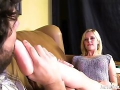 Pretty Blonde Gives A Guy A Footjob