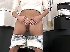 Charming Nympho Is Urinating And Masturbating Shaven Twat