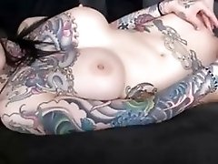 Tattooed Dark Brown With A-hole Plug Shows Her Large Breasts On Livecam